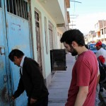 Andrew's host father, Romulo, opens the door to his home.