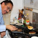 Peru SST Co-Director Richard R. Aguirre prepares more pancakes.