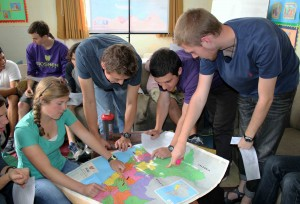 Students find their service locations on a map of Peru.