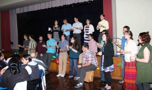 Students sing a song of welcome to their host families.
