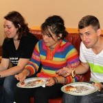 Sierra, Edith and Stefan enjoy familiar food and conversation.