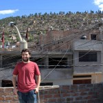 Andrew poses beside his rooftop bedroom.