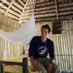 Derek inside the bamboo hut where he sleeps.