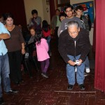 Alejandro's host father, Benjamin Salas Aguirre, plays a ring toss game.