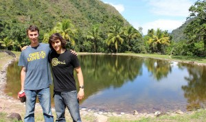 Joel and Lucas beside a pond at the Kimo camp.