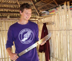 Derek shows the machete he purchased to help with chores on his family's farm.