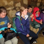 The students wait out a short rainstorm in an Inca shelter.