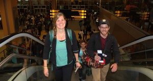 Emma, Stefan and Brian walk upstairs toward their airline departure gate.