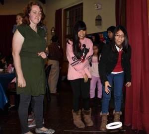 Sierra's host sisters, Maria and Jimena, play a ring toss game.