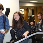 Brody, Miranda, Andrew, Matt and other students head to the airline departure gate.