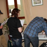 Brian, Sierra and Tim sign up for a role in Sunday workshop and to reserve a time to present their service project.