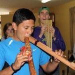 We got to try out the instruments. Alejandro goes for two flutes at once.