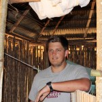Michael in the hut where he sleeps.