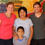 Emma and Stefan with their supervisor, INABIF Director Doris Espinoza Leon, and a young boy.