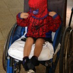A young Spiderman waits for his snack.