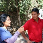 Raquel talks to Alejandro about the clinic's garden.