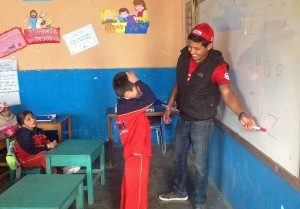 Alejandro makes a connection with a student.