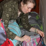 Leah finishes repacking her bag,
