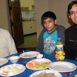Goshen College Spanish teacher Moises Arce and his sons at the farewell party.