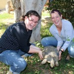 Miranda and Jaime play with an unusual resident of the clinic grounds.