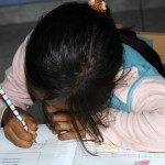 A student practices her writing.