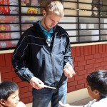 Matt distributes hand sanitizer to students.