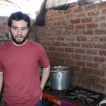 Andrew helps prepare food in this kitchen.