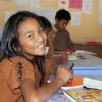 A student flashes a lovely smile.