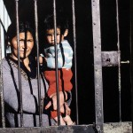 A woman accused of being a Shining Path guerrilla with her son in a Cusco prison. The child was the result of the rape of the woman by a police officer.