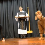 Martin de Porres prepares to feed a cat and dog, played by Joel and Lucas.