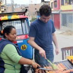 Andrew helps Alicia with the anticuchos.