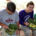 Michael and Derek enjoy their lunch – smoked chicken and rice wrapped in banana leaves.