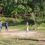 Children play volleyball after class.