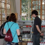 Sierra and Brody check out the products for sale at the Floralp dairy and cheese-making factory in Oxapampa.