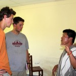 Frank Dieter, a San Miguel leader, talks to Derek and Michael about their assignment running the library.