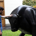 Andrew mind-melds with a bull sculpture.