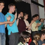 Students offer applause to thank their host families.