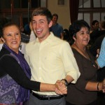 Stefan and Alejandro dance with their host mothers, Sonia Peralta Olaechea and Livia Salas Achahuanco.