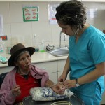 Edith assists a patient.
