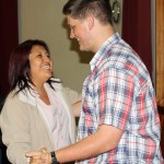Michael dances with his host mother, Betty Lozano Cahuana.