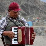 For a few soles, the musician played a song in Quechua and another in Spanish.