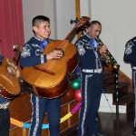Mariachi musicians play for the host parents.