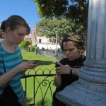 Leah and Edith take advantage of the free WiFi service in the main plaza.