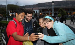 Alejandro shows Andrew, Edith and Leah a photograph he took of a gigantic spider.