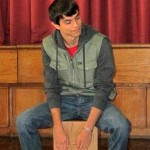 Armando playing the cajón during a workshop.