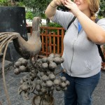Blog Adriene with bird sculpture IMG_0550