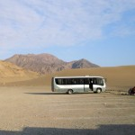 Our bus stands alone in the parking lot at the end of the day in Caral.