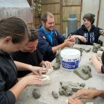 Danielle, Max, Bryan, Lydia, Laura working with clay.