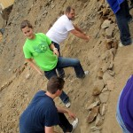Max, Mariah and Bryan, working at odd angles to put rocks in place.