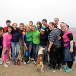 The group poses at the top of the hill with Carmina's dog.